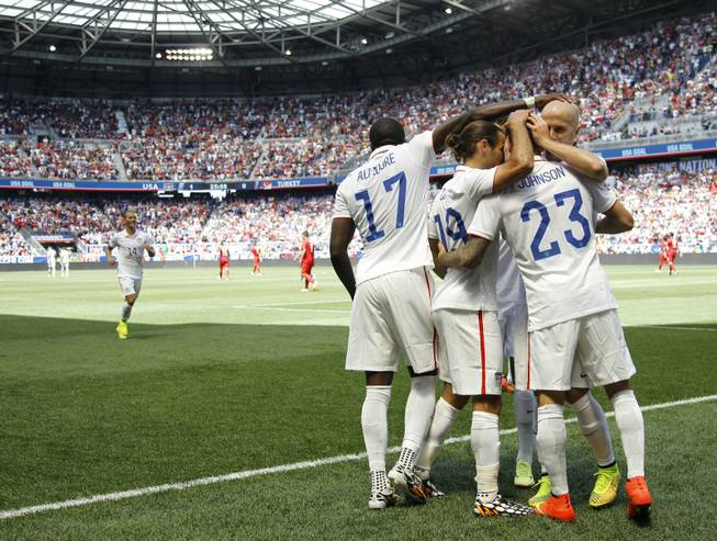 United States' Fabian Johnson (23) is congratulated by teammates after scoring a goal against Turkey in the first half of an international friendly soccer match on Sunday, June 1, 2014, in Harrison, N.J. The U.S. won 2-1.