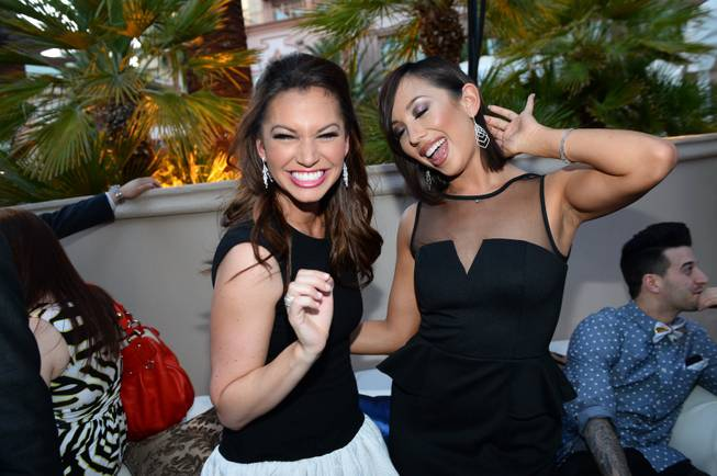 Melissa Rycroft, left, and Cheryl Burke pose with their jewelry during the annual Simon G. Soiree at the Four Seasons Hotel Saturday, May 31, 2014.