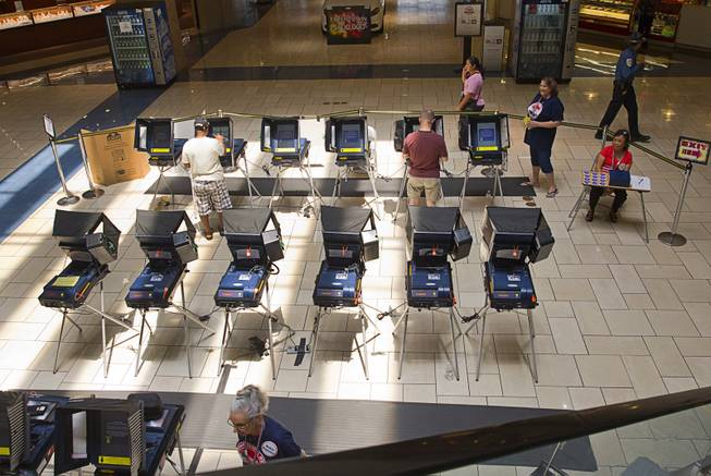 Voters cast their ballots during early voting at the Meadows Mall on Monday, June 2, 2014.