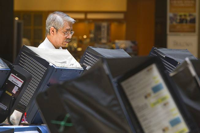 Sergio Rueda, 61, votes at the Meadows Mall Monday, June 2, 2014. Early voting for the 2014 primary election continues through Friday June 6 at 83 sites.