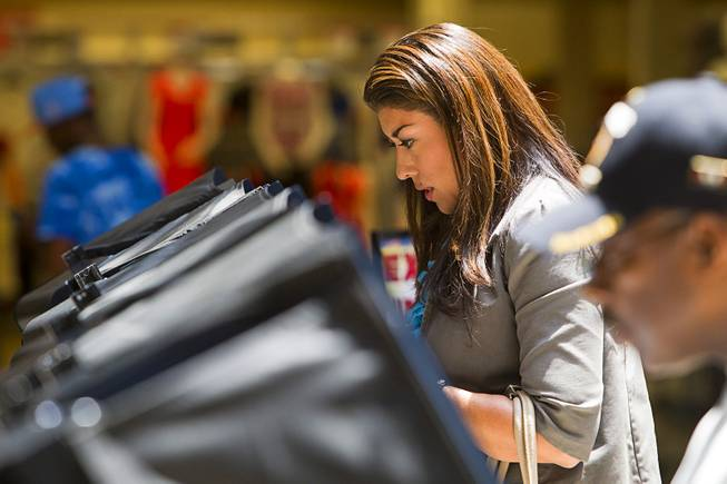Lucy Flores, Democratic candidate for Lieutenant Governor, votes at the Meadows Mall Monday, June 2, 2014. Early voting for the 2014 primary election continues through Friday June 6 at 83 sites.