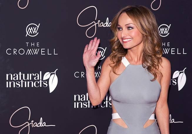Celebrity chef Giada De Laurentiis waves from the red carpet as she arrives during the VIP grand opening of Giada, the first Giada De Laurentiis restaurant, on Monday, June 2, 2014, in the Cromwell.