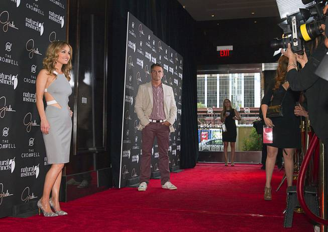 Celebrity chef Giada De Laurentiis, with her publicist Stephen Huvane at right, arrives during the VIP grand opening of Giada, the first Giada De Laurentiis restaurant, on Monday, June 2, 2014, in the Cromwell.