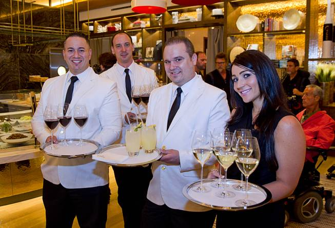 Servers greet guests with wine and fresh basil lemonade during the VIP grand opening of Giada, the first Giada De Laurentiis restaurant, on Monday, June 2, 2014, in the Cromwell.