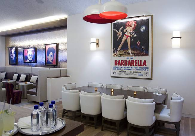 "A dining area is shown during the VIP grand opening of Giada, the first Giada De Laurentiis restaurant, on Monday, June 2, 2014, in the Cromwell. The movie poster on the wall is a nod to her grandfather Agostino ""Dino"" De Laurentiis, who produced ""Barbarella,"" a 1968 film starring Jane Fonda."