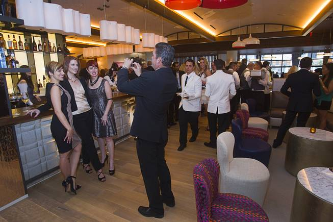 Karie Hall, general manager of the Cromwell, is flanked by guests during the VIP grand opening of Giada, the first Giada De Laurentiis restaurant, on Monday, June 2, 2014, in the Cromwell. The restaurant opens to the public Tuesday.