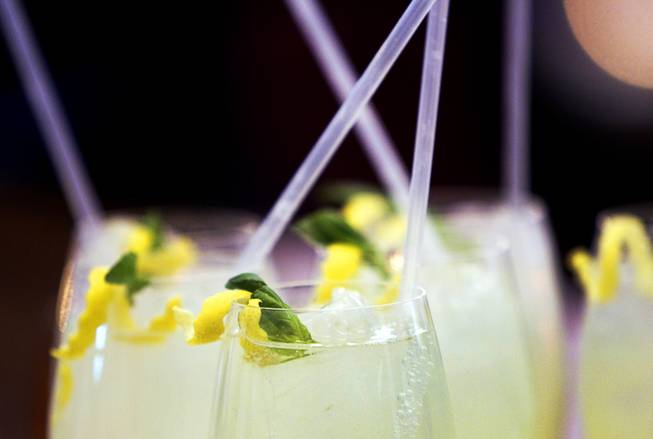 Glasses of basil lemonade are served during the VIP grand opening of Giada, the first Giada De Laurentiis restaurant, on Monday, June 2, 2014, in the Cromwell. The restaurant opens to the public Tuesday.