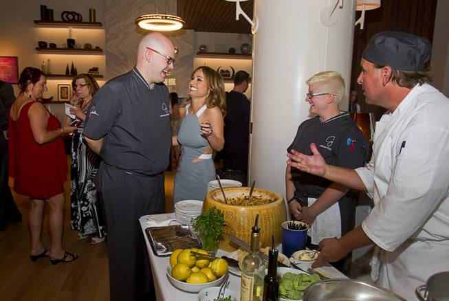 Chef Kurtess Mortensen and celebrity chef Giada De Laurentiis stop by a serving station during the VIP grand opening of Giada, the first Giada De Laurentiis restaurant, on Monday, June 2, 2014, in the Cromwell.