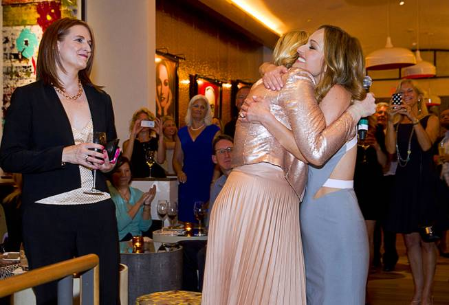 Celebrity chef Giada De Laurentiis, right, is embraced by Eileen Moore, president of the Cromwell, as Cromwell General Manager Karie Hall looks on during the VIP grand opening of Giada, the first Giada De Laurentiis restaurant, on Monday, June 2, 2014, in the Cromwell.