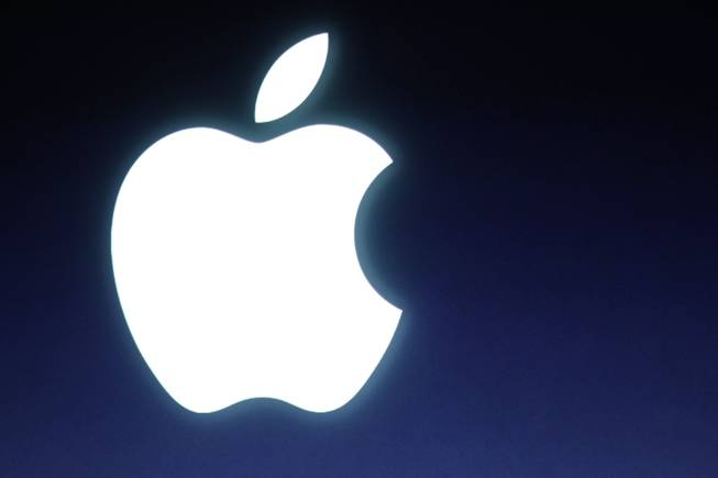 In this Tuesday, Oct. 4, 2011, file photo, an Apple logo is seen during an announcement at Apple headquarters in Cupertino, Calif.
