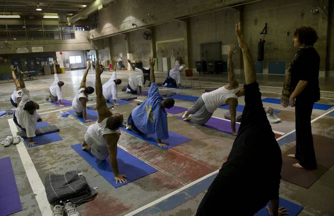 Yoga instructor, Iwona, right, and Zack Pasillas, outreach director with the Yoga Seed Collective, teach a weekly yoga class inside the California State Prison in Sacramento, Calif., on April 30, 2014.