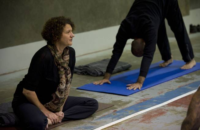 Yoga instructor, Iwona, left, leads inmates through Vinyasa yoga as Zack Pasillas, founder and outreach director with Yoga Seed Collective, demonstrates poses, on April 30, 2014, at the California State Prison in Sacramento, Calif.