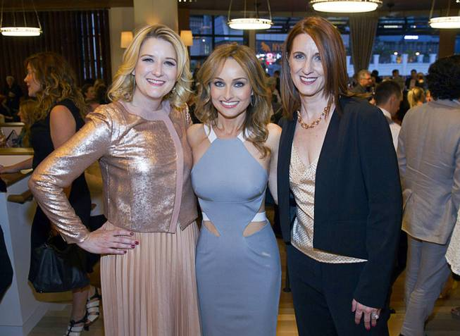 Celebrity chef Giada De Laurentiis, center, with Eileen Moore, left, president of the Cromwell, and Karie Hall, general manager, during the VIP grand opening of Giada, the first Giada De Laurentiis restaurant, on Monday, June 2, 2014, in the Cromwell. The restaurant opens to the public Tuesday.