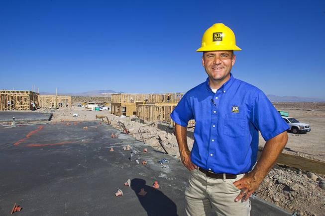 Jeff Spencer, a KB Homes regional construction manager, poses at a worksite at Inspirada in Henderson Tuesday, June 3, 2014. A number of formerly stalled or financially troubled master-planned communities are now back in business, with developers building and selling homes.