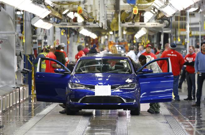 In this March 14, 2014, photo, a 2015 Chrysler 200 automobile moves down the assembly line at the Sterling Heights Assembly Plant in Sterling Heights, Mich.