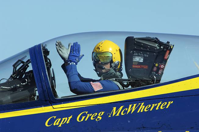 Capt. Greg McWherter, commanding officer and flight leader of the U.S. Navy flight demonstration squadron, the Blue Angels, responds to the crowd at the Guardians of Freedom Air Show in Lincoln, Neb., Sept. 10, 2011.