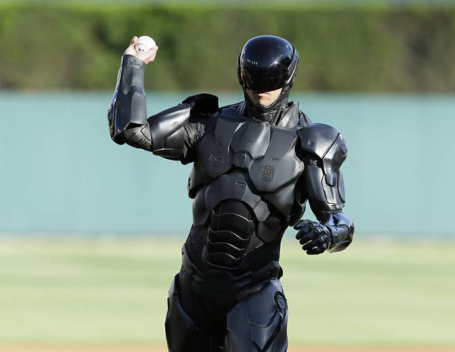 The movie character Robocop throws out a ceremonial first pitch before a baseball game between the Detroit Tigers and the Toronto Blue Jays in Detroit, Tuesday, June 3, 2014.