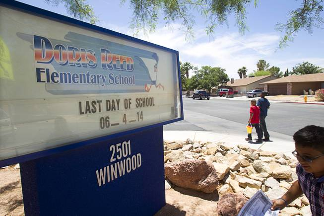 Children leave Reed Elementary School on the last day of school Wednesday, June 4, 2014. The Clark County School District and law enforcement agencies share information to curb fights, out-of-control parties and other problems.