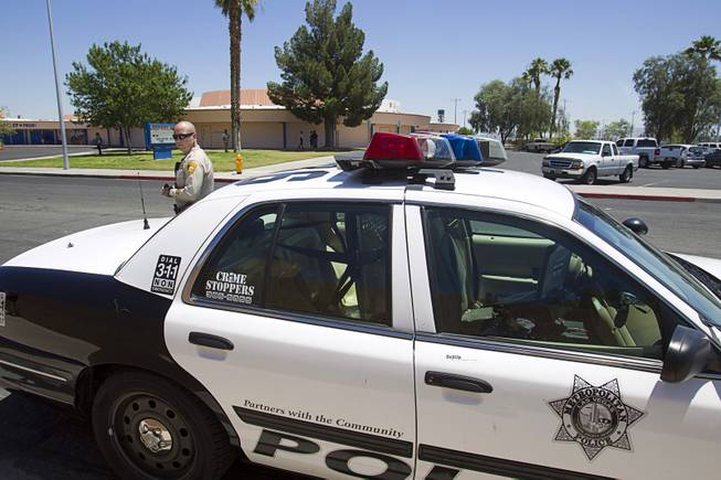 Metro Police Officer Roberto Henderson parks by Brinley Middle School Wednesday, June 4, 2014. The Clark County School District Police and other law enforcement agencies share information to curb fights, out-of-control parties and other problems on the last day of school.
