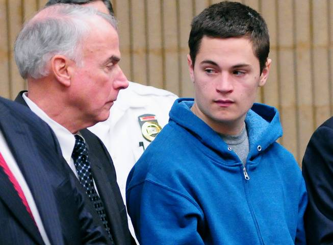 Christopher Plaskon, 16, right, stands with appointed guardian, his uncle Paul Healy, during a hearing in his public court appearance at Superior Court on Friday, May 2, 2014, in Milford, Conn.