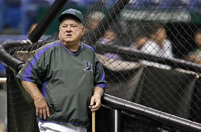 In this Sept. 21, 2007 file photo, Tampa Bay Devil Rays special adviser Don Zimmer leans against the batting cage before a baseball game between the Devil Rays and Boston Red Sox, in St. Petersburg, Fla.