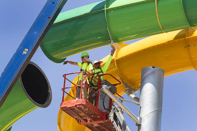 "Workers line up the final piece of the ""Breaker 1-9"" water slide at the Cowabunga Bay water park in Henderson Thursday, June 5, 2014. Developers announced today that the water park will open July 4. The park includes a 32,000-square-foot wave pool, water slides and a 1,200-foot-long lazy river."