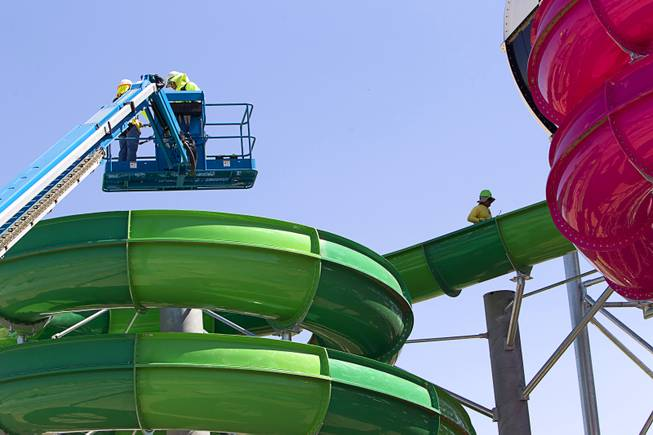 "Workers are shown on the ""Breaker 1-9"" water slide at the Cowabunga Bay water park in Henderson Thursday, June 5, 2014. Developers announced that the water park will open July 4. The park includes a 32,000-square-foot wave pool, water slides and a 1,200-foot-long lazy river."