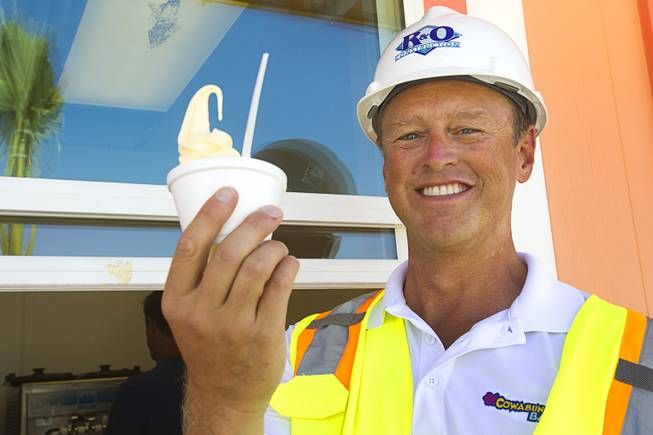 Shane Huish, general manager of the Cowabunga Bay water park, poses with a Dole Pineapple Whip at the park in Henderson Thursday, June 5, 2014. Developers announced that the water park will open July 4. The park includes a 32,000-square-foot wave pool, water slides and a 1,200-foot-long lazy river.