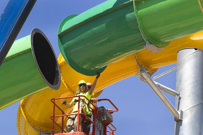 "Workers line up the final piece of the ""Breaker 1-9"" water slide at the Cowabunga Bay water park in Henderson Thursday, June 5, 2014. Developers announced that the water park will open July 4. The park includes a 32,000-square-foot wave pool, water slides and a 1,200-foot-long lazy river."