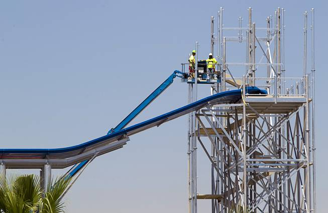 Construction continues on a water slide at the Cowabunga Bay water park in Henderson Thursday, June 5, 2014. Developers announced that the water park will open July 4. The park includes a 32,000-square-foot wave pool, water slides and a 1,200-foot-long lazy river.
