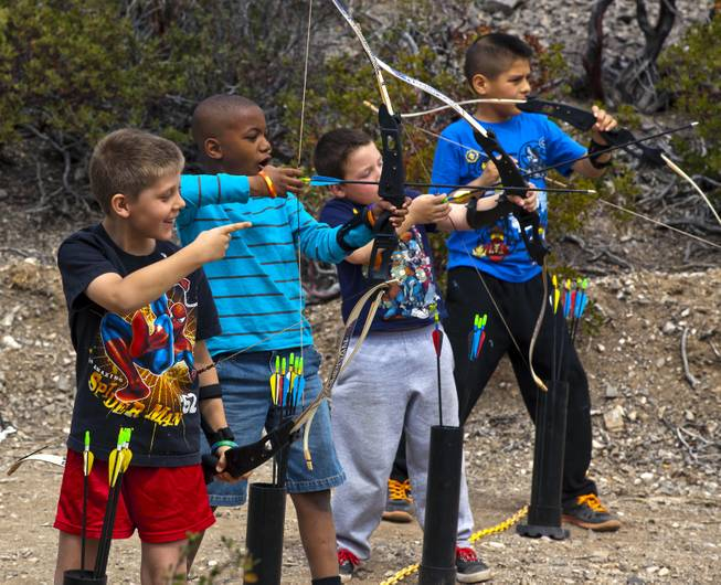 Campers laugh as an archery lesson continues during Camp Vegas at Pitosi Pines sponsored by the Nevada Diabetes Association Tuesday, April 15, 2014.