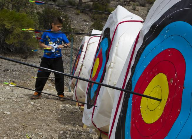 A camper retrieves his arrows at an archery lesson during Camp Vegas at Pitosi Pines sponsored by the Nevada Diabetes Association Tuesday, April 15, 2014.
