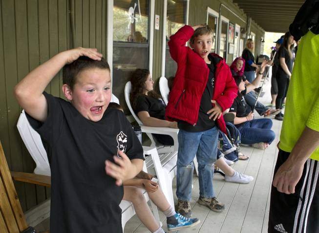 Camper Carter Davidson, 8, pats his head and rubs his tummy during a game at Camp Vegas within Pitosi Pines sponsored by the Nevada Diabetes Association Tuesday, April 15, 2014.