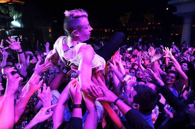 Macklemore crowd surfs during Surrender and Encore Beach Club's fourth-anniversary ...