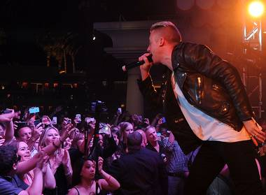 Macklemore performs during Surrender and Encore Beach Club's fourth-anniversary celebration early Thursday, June 5, 2014, in Encore Las Vegas.