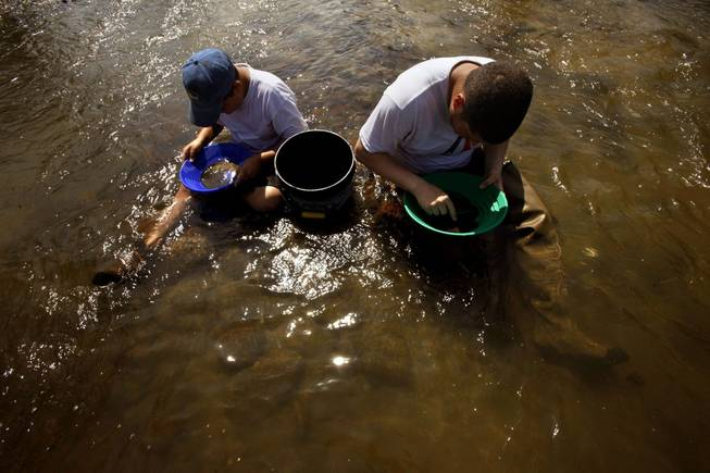 Drought conditions have lowered water levels in California and given prospectors like Brock O'Dell, 12, left, and his cousin, Anthony O'Dell, the chance to pan for gold in areas previous not accessible.