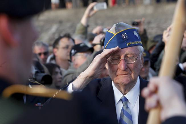 World War II veteran of the U.S. 29th Infantry Division, Morley Piper, 90, Mass., salutes during a D-Day commemoration, on Omaha Beach in Vierville sur Mer, western France , Friday June 6, 2014. Veterans and Normandy residents are paying tribute to the thousands who gave their lives in the D-Day invasion of Nazi-occupied France 70 years ago.
