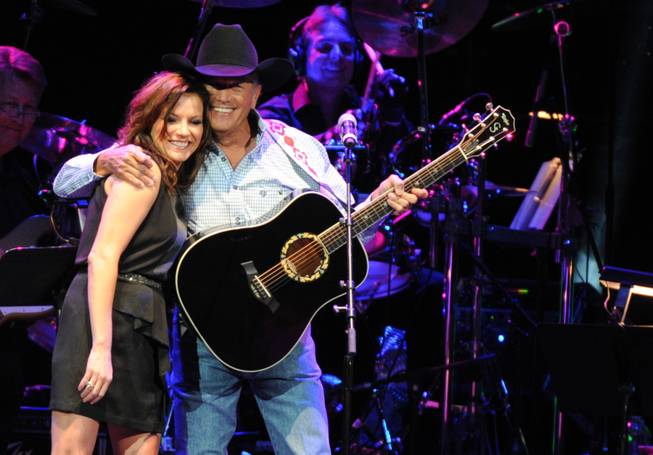 "Martina McBride and George Strait perform during ""George Jones Tribute — Playin' Possum: The Final No Show,"" on Friday, Nov. 22, 2013, at Bridgestone Arena in Nashville."