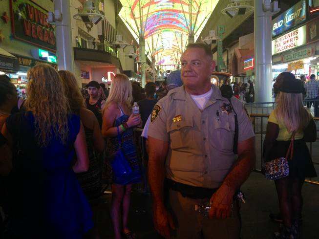 Metro Police Detective R. Bass stands at the 4th Street entrance to the Fremont Street Experience, where heavy security and police were employed to maintain watch over an expected crowd of some 40,000 people.