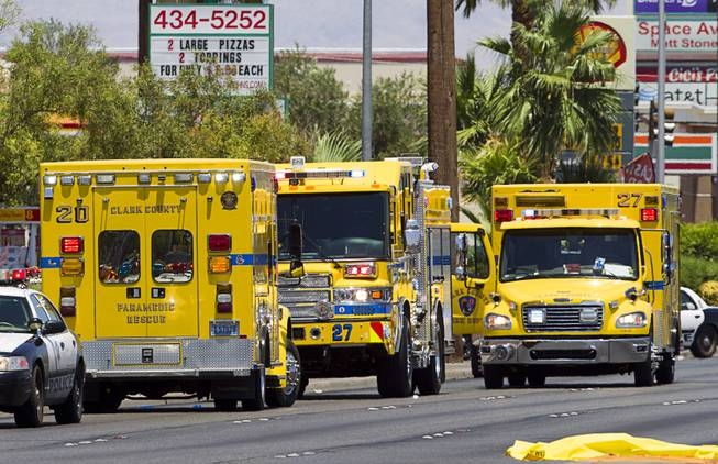 Clark County Fire Department rescue units stage on Nellis Boulevard Sunday, June 8, 2014. Two suspects shot two Metro Police officers in a nearby pizza shop then fled to the Wal-Mart where they shot and killed another person, police said. Both officers died of their injuries.