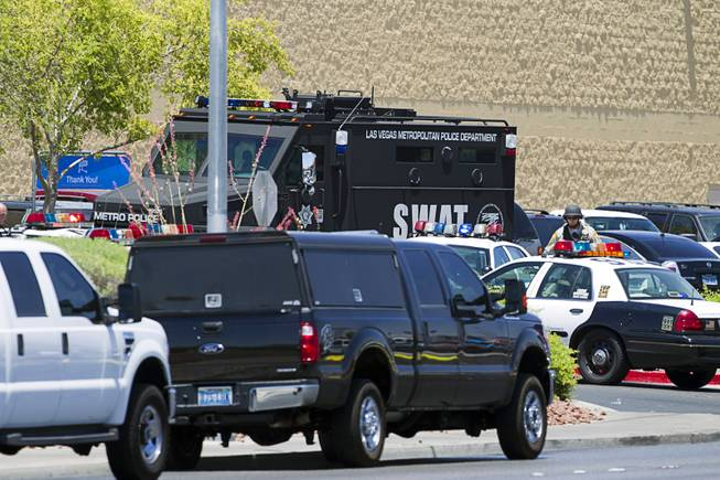 A Metro Police SWAT vehicle is shown outside a Wal-Mart on Nellis Boulevard Sunday, June 8, 2014. Two suspects shot two Metro Police officers in a nearby pizza shop then fled to the Wal-Mart where they shot and killed another person, police said. Both officers died of their injuries.