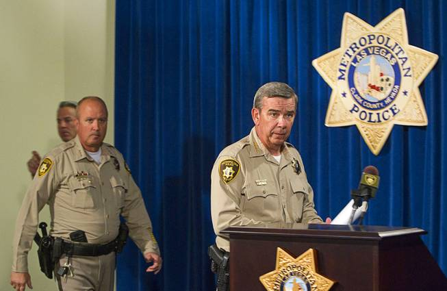 Clark County Sheriff Doug Gillespie, right, arrives for a news conference at Metro headquarters following the death of two officers and a citizen Sunday, June 8, 2014. Two suspects shot two Metro Police officers in a pizza shop then fled to a nearby Wal-Mart where they shot and killed another person, police said. The suspects are both dead.