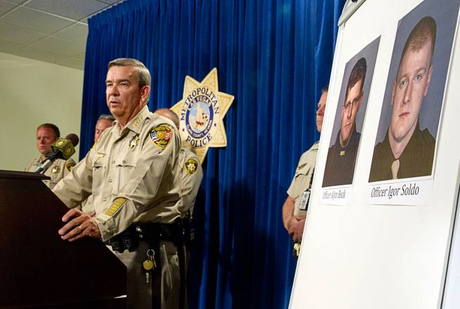 Clark County Sheriff Doug Gillespie speaks during a news conference at Metro headquarters following the death of two officers and a citizen Sunday, June 8, 2014. Two suspects shot two Metro Police officers, photos at right, in a pizza shop then fled to a nearby Wal-Mart where they shot and killed another person, police said. The suspects are both dead.