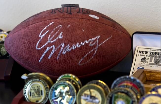 Sheriff Gillespie, as a big New York Giants fan, has an autographed Eli Manning football in his office at Metro Headquarters on Friday, June 6, 2014.
