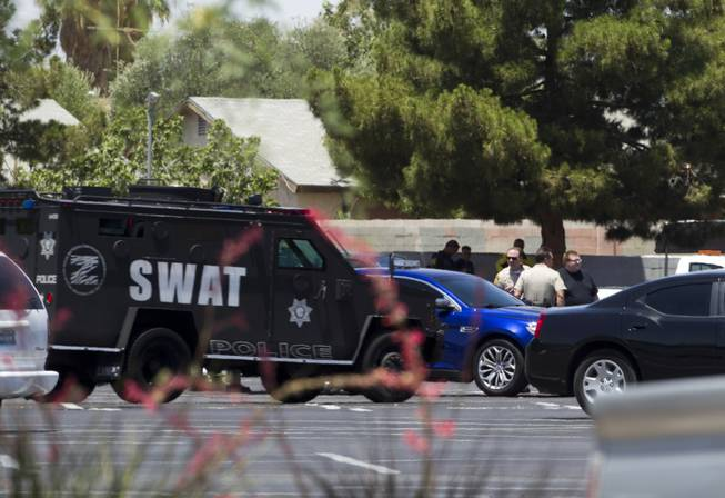 A Metro Police SWAT vehicle arrives at a Wal-Mart on Nellis Boulevard on Sunday, June 8, 2014. Two suspects allegedly shot two Metro Police officers in a nearby pizza shop, then fled to the Wal-Mart, where they fired shots before killing themselves.