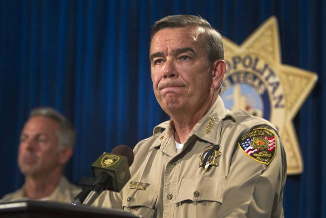 Sheriff Doug Gillespie takes questions during a news conference at Metro headquarters following the death of two officers and a citizen Sunday, June 8, 2014. Two suspects, also dead, shot two Metro Police officers at CiCi's Pizza on Nellis Boulevard, then fled to a nearby Wal-Mart, where they shot and killed another person.