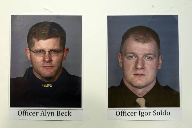 Photos of fallen Metro Police Officers Alyn Beck, left, and Igor Soldo are displayed during a news conference at Metro headquarters following the death of the two officers and a citizen Sunday, June 8, 2014. Two suspects, also dead, shot the officers at CiCi's Pizza on Nellis Boulevard, then fled to a nearby Wal-Mart, where they shot and killed another person before killing themselves.