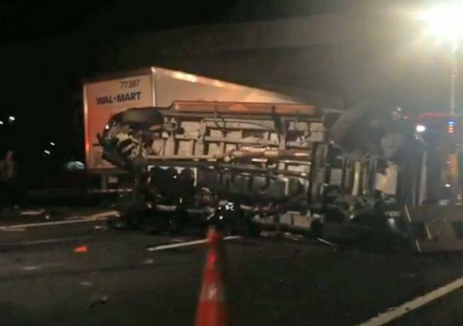 In this image from video the limousine bus carrying Tracy Morgan and six other people lies on its side early Saturday morning June 7, 2014, on the New Jersey Turnpike. Morgan remained hospitalized as state and federal officials continued their investigation of the six-vehicle crash on the New Jersey Turnpike that took the life of a Morgan friend and left two others seriously injured, authorities say.