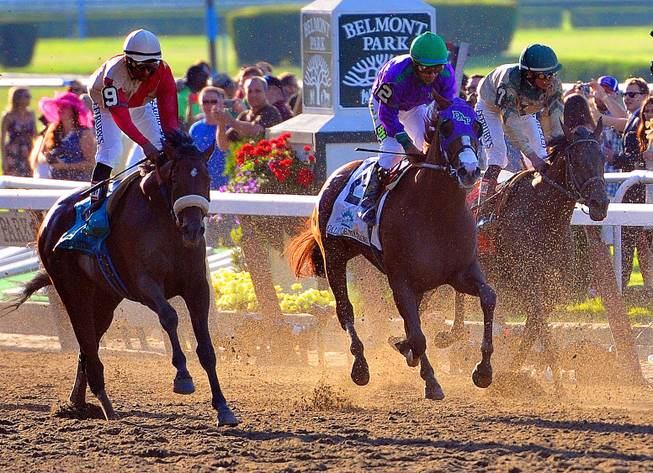 Victor Espinoza aboard California Chrome (2) rides past the finish line during the Belmont Stakes at Belmont Park, Saturday, June 7, 2014, in Elmont, N.Y. Tonalist went on to win the race, denying California Chrome the Triple Crown victory.