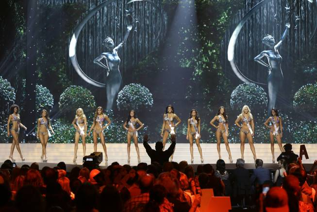 Contestants participate in the bathing suit competition during the 2014 Miss USA preliminary competition in Baton Rouge, La., Wednesday, June 4, 2014.